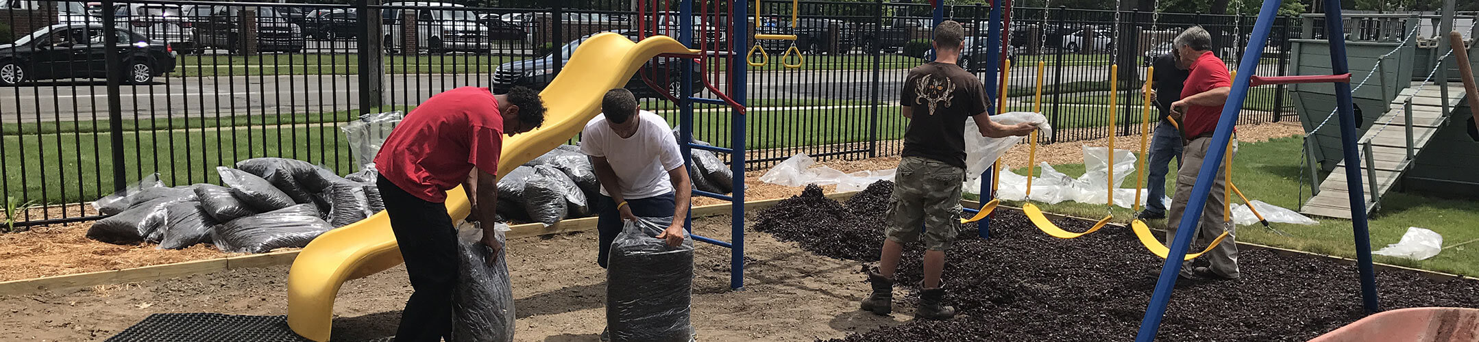 Volunteers Upkeeping Playground