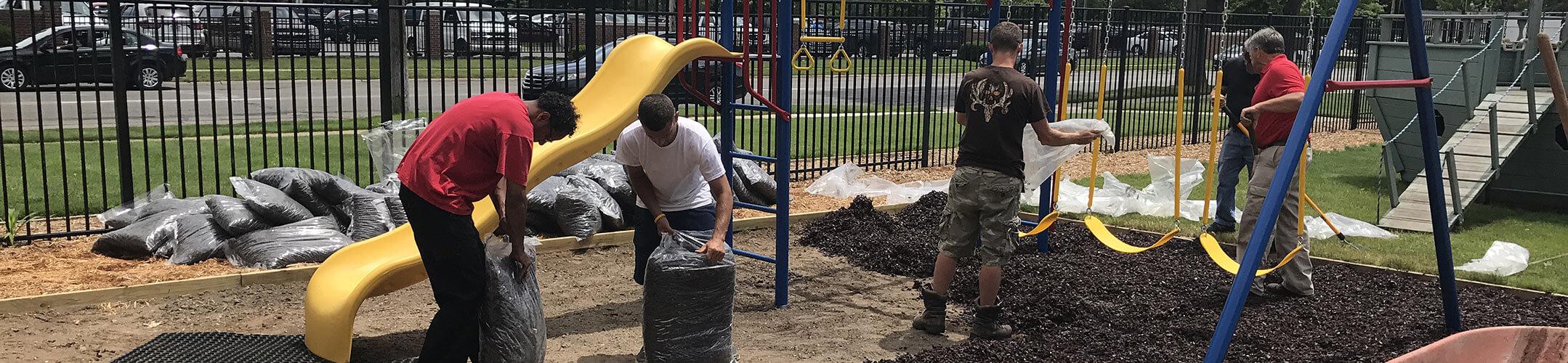 Volunteers Upkeeping Playground